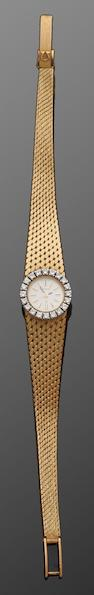 Omega: An 18ct gold and diamond set wristwatch