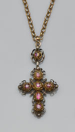 A ruby and diamond set cross pendant on chain