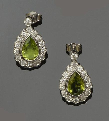 A pair of peridot and diamond earrings