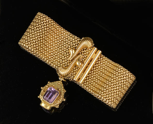 A yellow precious metal fancy-link bracelet with amethyst pendant