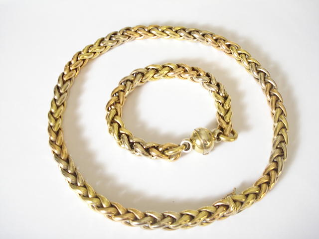 An 18ct gold necklace and bracelet suite