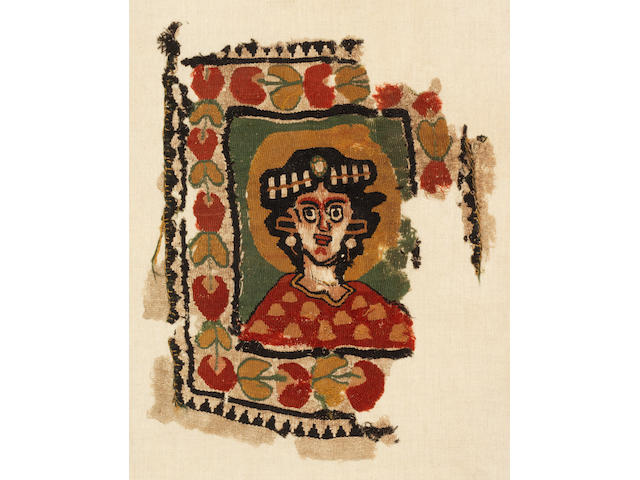 A Coptic tapestry panel with a bust of a hallowed female