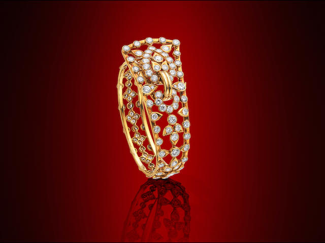 A diamond bangle, by Cartier,