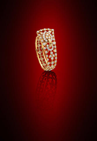 A diamond bangle, by Cartier,