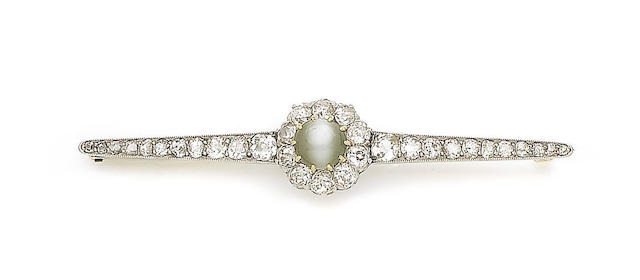 A cat's eye chrysoberyl and diamond bar brooch