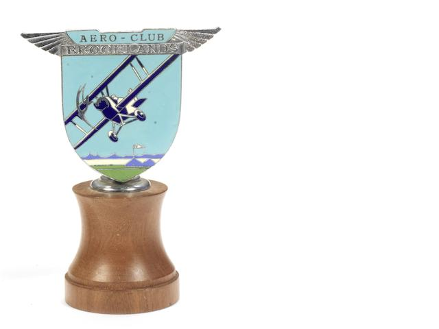 A Brooklands Aero-Club enamel badge by Spencer, London, late 1930s,