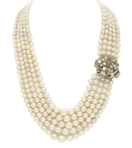 A multi-strand cultured pearl necklace with pyrite clasp, by Grima, (illustrated inside the front cover)