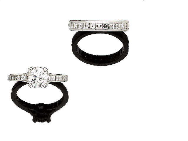 A diamond single-stone ring and a  diamond half hoop ring, by Tiffany & Co. (2)