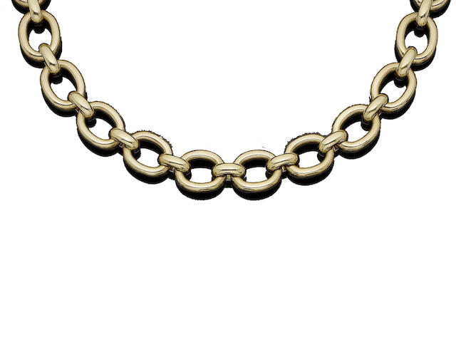 A gold fancy-link necklace, by Cartier