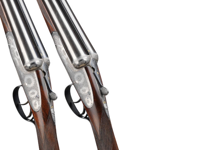 A pair of 12-bore assisted-opening round-bodied sidelock ejector guns by Boss & Co., no. 8577/8 In their 'V.C.' style leather case (handle partially detached)