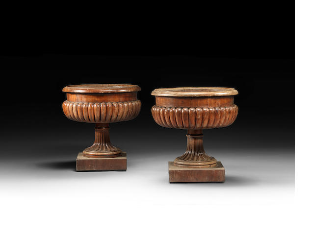 A pair of George IV carved mahogany wine coolers attributed to Gillows