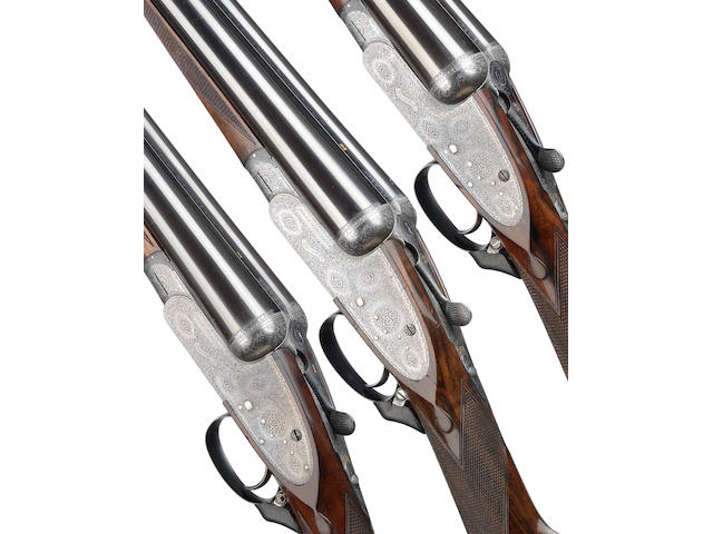 A trio of 12-bore single-trigger sidelock ejector guns by Boss & Co., no. 5609/10/11 In their brass-mounted oak and leather motor case and canvas cover (lock missing)
