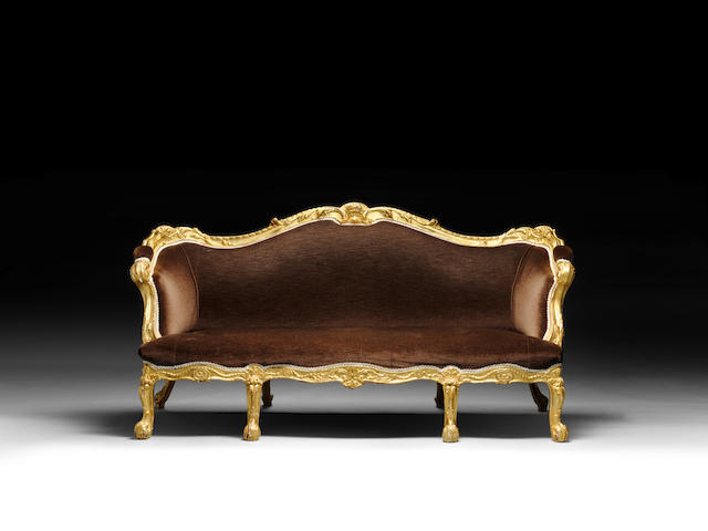An early George III carved giltwood sofa in the manner of Chippendale