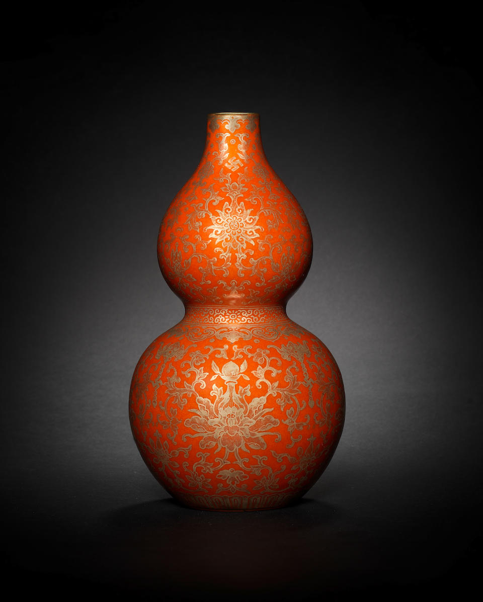 A rare Imperial coral-ground gilt-decorated double-gourd vase Jiaqing seal mark and of the period