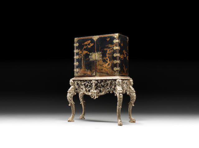 A Queen Anne black japanned cabinet on silvered stand