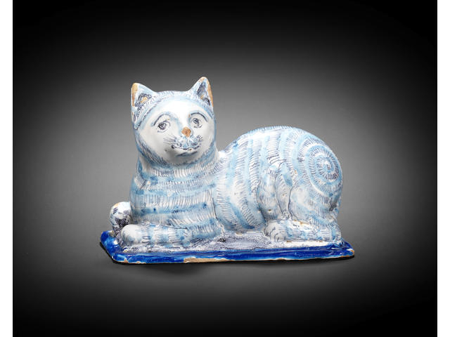 An extremely rare English delftware model of a cat, circa 1660-80