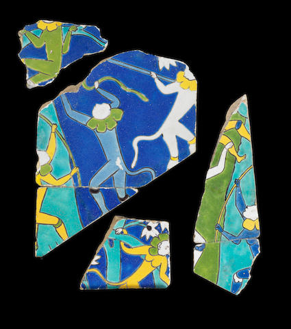 Four Safavid cuerda seca pottery Tile Fragments depicting performing monkeys Persia, 17th Century(4)