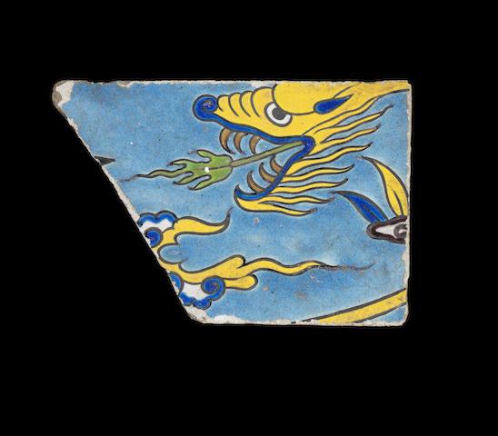 A rare Safavid cuerda seca pottery Tile Fragment depicting a Dragon Persia, 17th Century