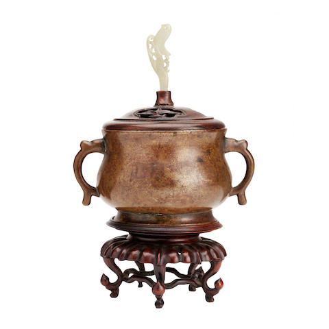 A small bronze incense burner with cover and stand Xuande six-character mark, but later