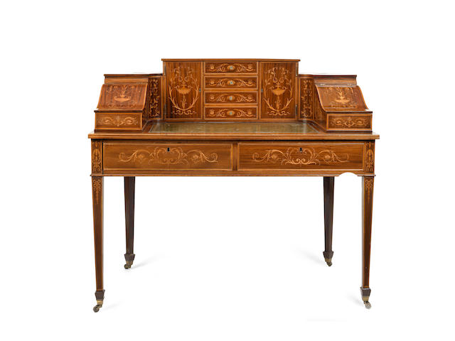 An Edwardian mahogany and fruitwood marquetry 'Carlton House' desk in the manner of Edwards and Roberts