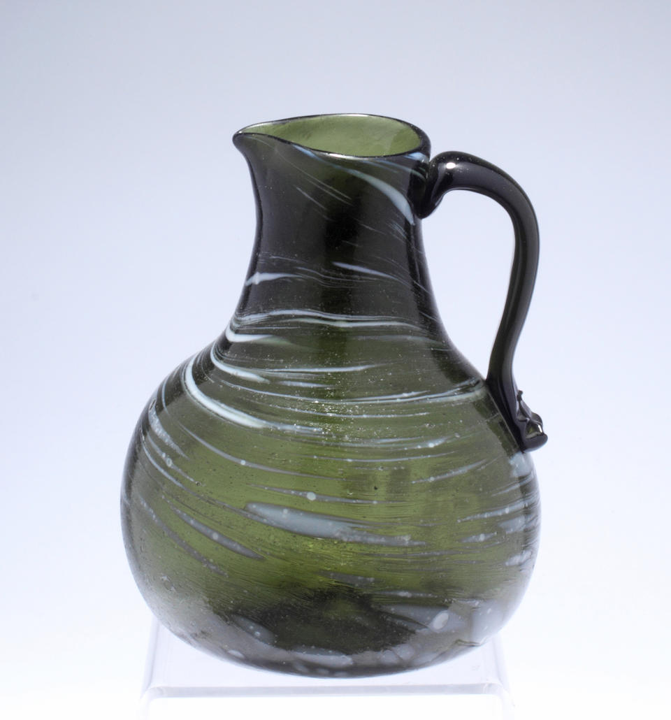 A sealed wine bottle together with a large quantity of Nailsea type glass Mostly 19th century