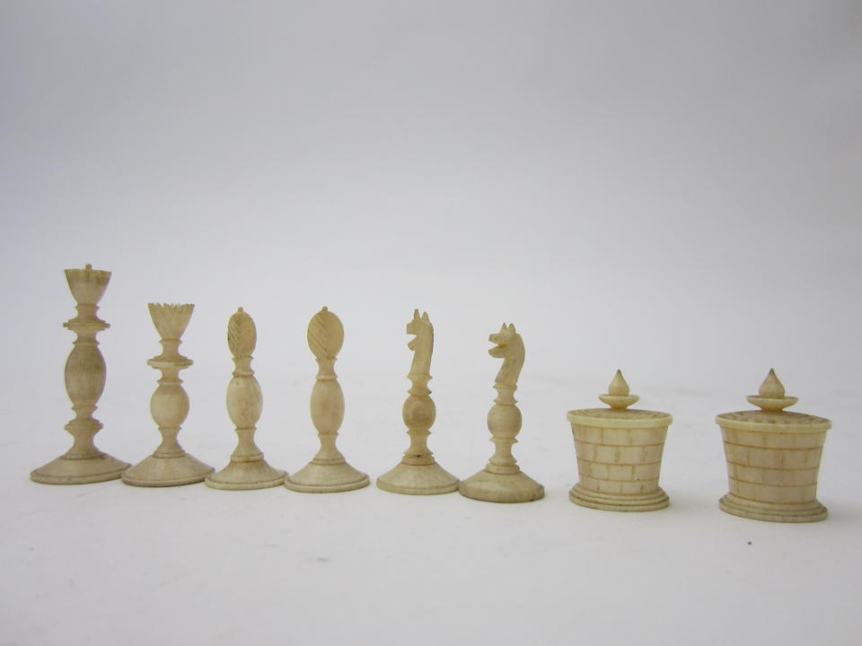 An Indian ivory and stained horn miniature chess table and box of pieces Vizagapatam early 20th century
