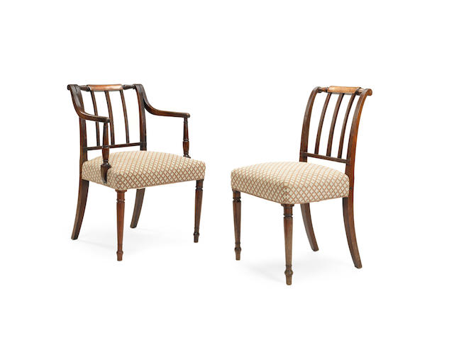 A matched set of sixteen late George III and later mahogany dining chairs