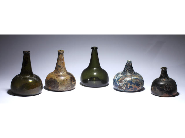 Five glass 'onion' shaped bottles, four Nailsea type bottles, three Nailsea type flasks and six various rolling pins