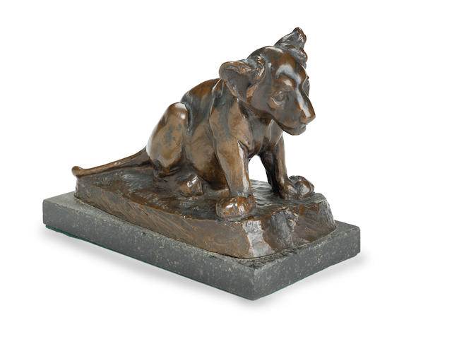 August Gaul (German, 1869-1921): A bronze model of a lion cub