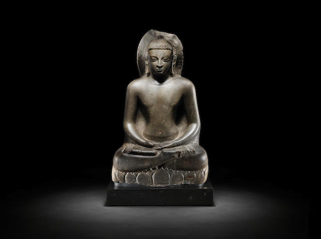 A grey stone seated Figure of Buddha Shakyamuni Licchavi period, Nepal, 6th/ 7th Century