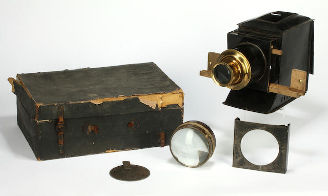 A collection of magic lantern slides and projector