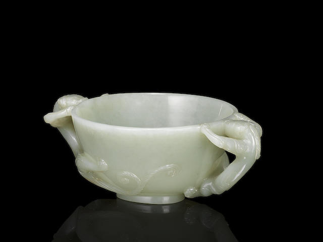 A pale green jade chilong-handled cup 17th/18th century