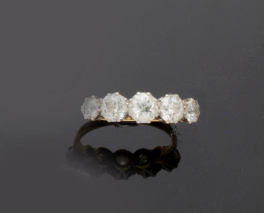 A diamond five stone ring
