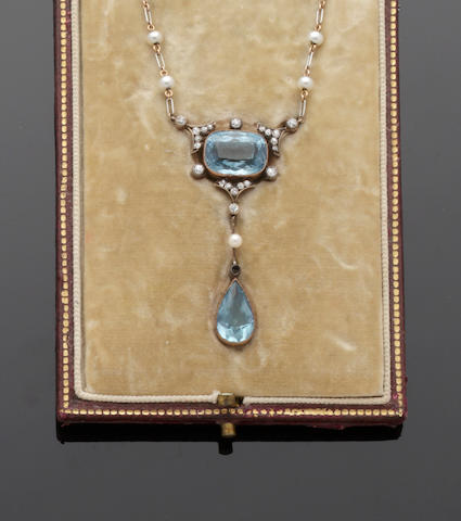An early 20th century aquamarine, diamond and seed pearl pendant necklace