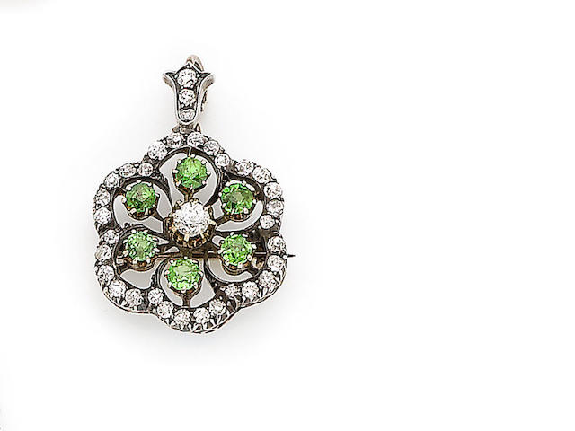 A demantoid garnet and diamond pendant/brooch,