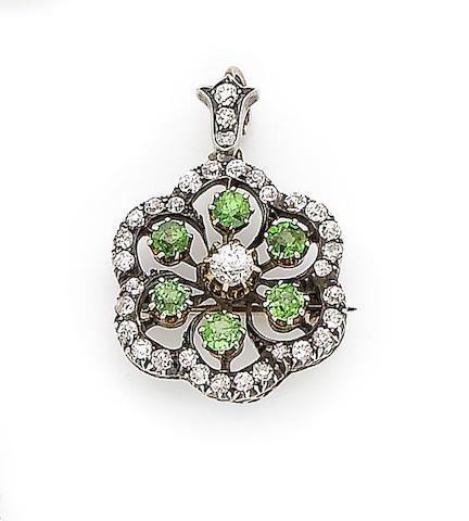 A demantoid garnet and diamond pendant/brooch,