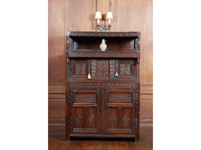 A rare Charles II oak canopied court cupboard, Westmorland, dated 1676
