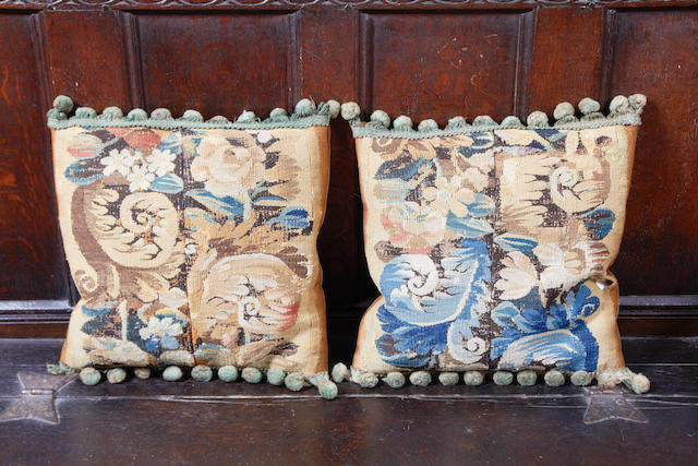 A pair of tapestry cushions