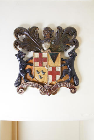 An early 18th century polychrome-decorated and gilt-highlighted armorial achievement, English