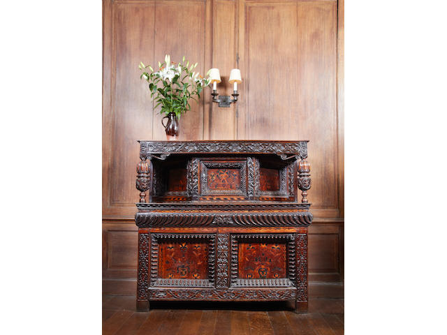 An impressive mid-17th century carved oak, marquetry and parquetry inlaid court cupboard, Leeds, Yorkshire, circa 1640-60