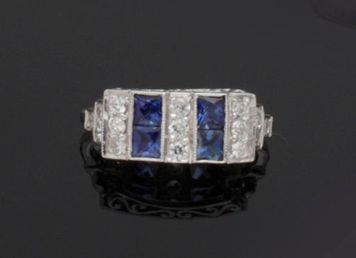 An Art Deco style diamond and sapphire ring