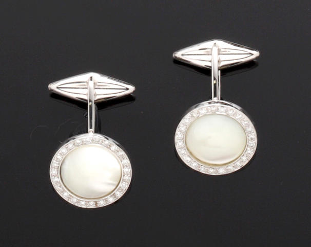 A pair of mother o' pearl and diamond cufflinks