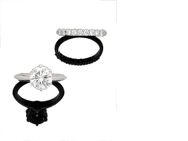 A diamond single-stone ring and a diamond half-hoop ring, by Tiffany & Co. (2)