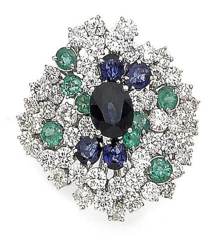 An emerald, sapphire and diamond dress ring