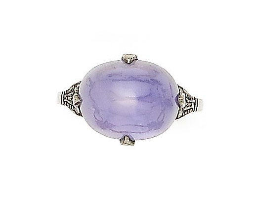 A star sapphire and diamond-set ring