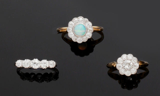 An opal and diamond cluster ring and two diamond dress rings (3)