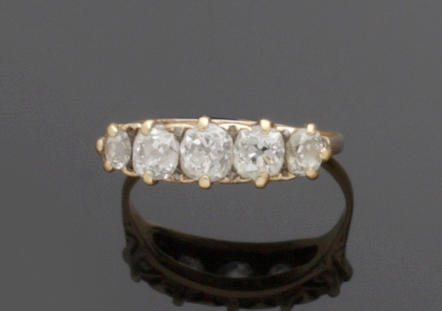 A late Victorian five stone diamond ring