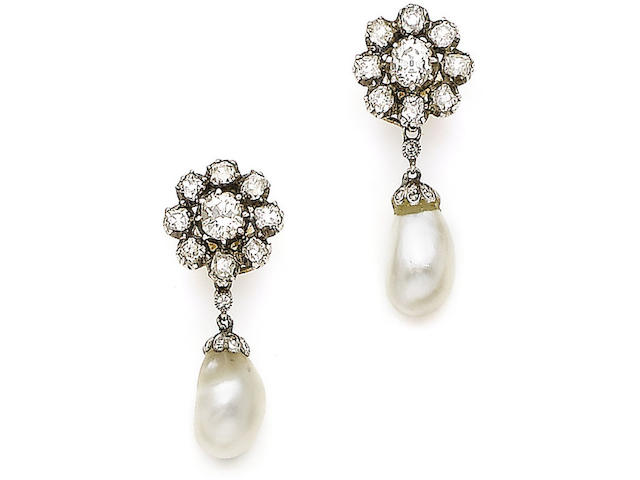 A pair of natural pearl and diamond earrings