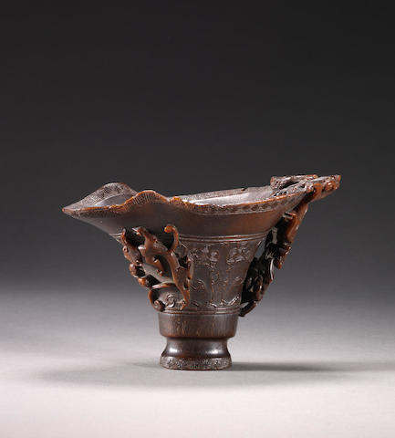 A rare archaistic rhinoceros horn incised libation cup 17th century
