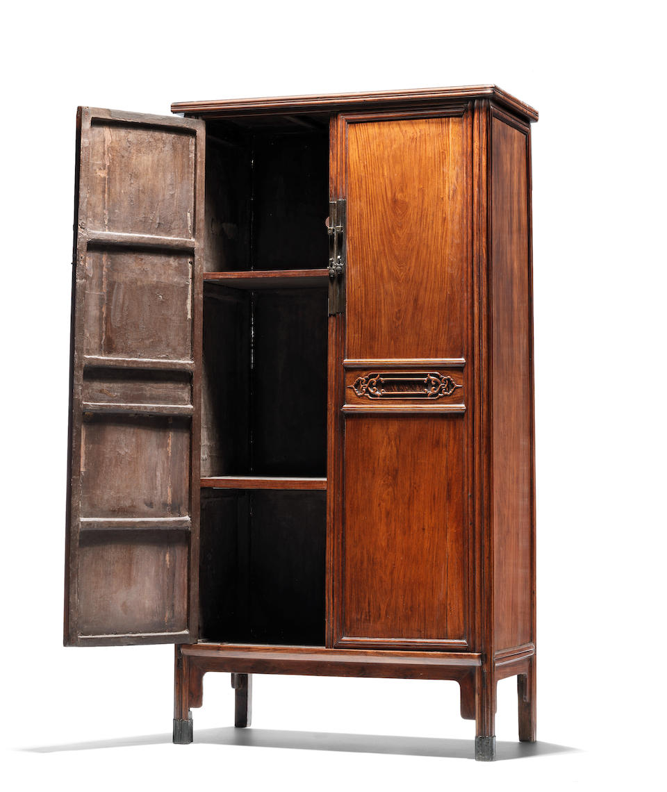 A rare large huanghuali tapered cabinet, yuanjiaogui Ming Dynasty, 17th century